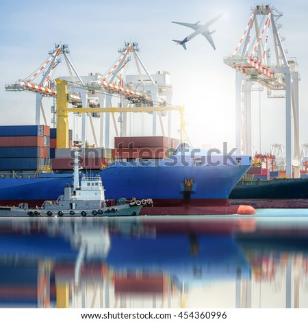 Logistics and transportation of International Container Cargo ship and and Cargo plane in a harbor with water reflections, Freight Transportation, Shipping, Nautical Vessel - stock photo