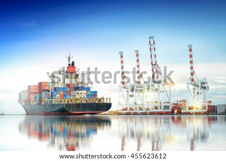 Logistics and transportation of International Container Cargo ship in a harbor with water reflections for logistic import export background and transport industry. - stock photo
