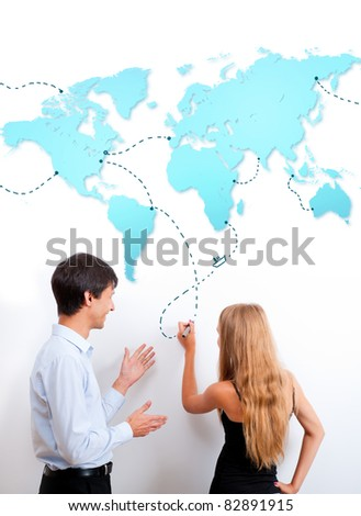 Logistics lesson. Teacher helping to his student with heading. They are drawing route - stock photo