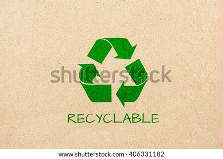 logo recycle on brown paper background - stock photo