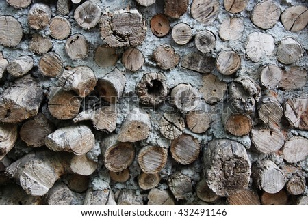 Logs and mud wall of an old house - stock photo