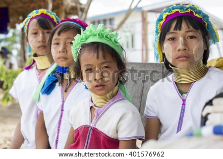 LOIKAW, MYANMAR - JANUARY 24, 2016: A portrait of a group of children from the Padaung tribe (Karen) who are famous for wearing large brass coils around their neck. - stock photo