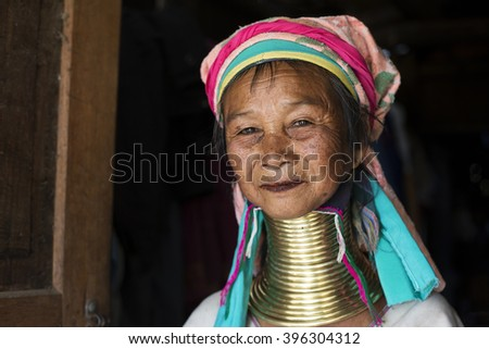 LOIKAW, MYANMAR - JANUARY 24, 2016: A portrait of a woman from the Padaung tribe (Karen) who are famous for wearing large brass coils around their neck.  - stock photo