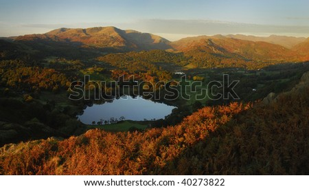 Loking over Loughrigg Tarn towards the Coniston Fells from Loughrigg, in the English Lake District - stock photo
