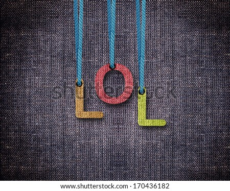 Lol Letters hanging strings with blue sackcloth background. - stock photo