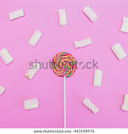 Lollipop and Marshmallow on pink background