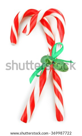 Lollipop candies with stripe and mint, isolated on white