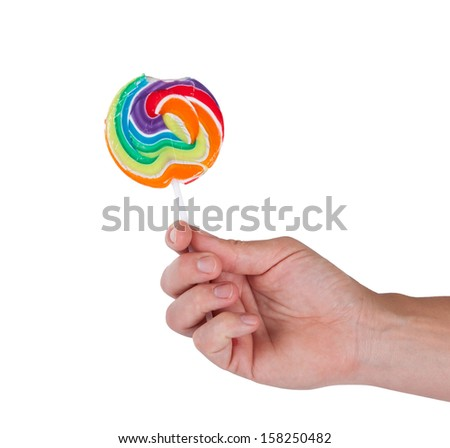 Lollipop in hand isolated on white background - stock photo
