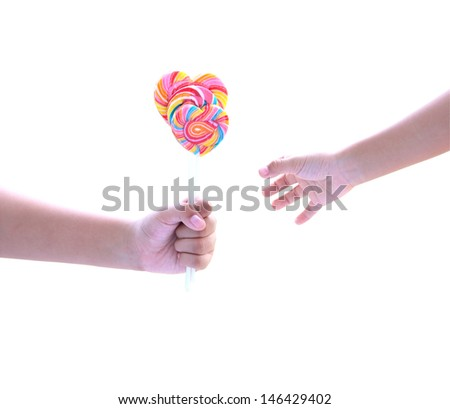 Lollipop in hand isolated on white with clipping path - stock photo
