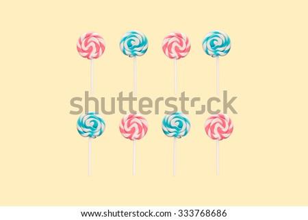 Lollipop - mixed pop on yellow - stock photo