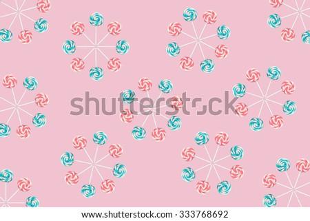 Lollipop wheels on pink - stock photo