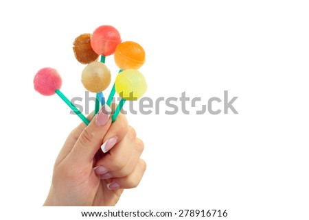 lollipops in hand isolated on white - stock photo