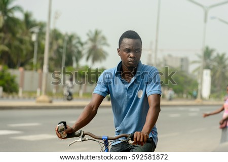 Happy Young Man Riding Electric Bike Stock Photo 624698720