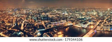 London aerial view panorama at night with urban architectures and bridges. - stock photo