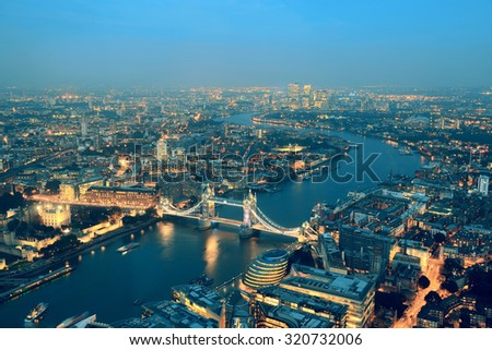 London aerial view panorama at night with urban architectures and Tower Bridge. - stock photo
