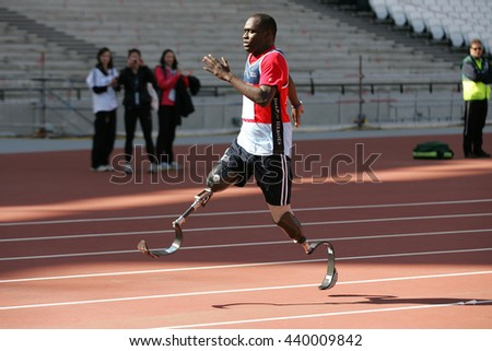 LONDON - APR 1, 2012:  A contestant takes part at the Gold Challenge Olympic Stadium Event held at the Olympic Park in Stratford on Apr 1, 2012 in London