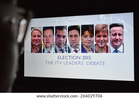 LONDON - APR 4:  A viewer watches election live TV debate on a computer monitor on Apr 4, 2015 in London, UK. The UK goes to the polls on May 7 in the closest fought general election for generations. - stock photo