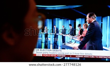 LONDON - APR 2: A viewer watches election live TV debate on a computer monitor on Apr 2, 2015 in London, UK. The UK goes to the polls on May 7 in the closest fought general election for generations. - stock photo