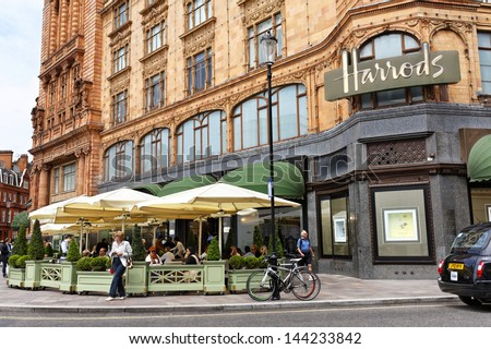 LONDON - APR 5 : front entrance to Harrods pictured on April 5th, 2013, in London, UK. This department store was opened at 1824 and now it is one of the most famous luxury store in London. - stock photo