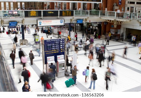 LONDON - APR. 24 : Inside view of Liverpool Street, since 1874, third busiest railway terminus in London after Waterloo and Victoria on April 24, 2013. - stock photo