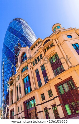 LONDON - APR 20: The modern Gherkin tower pictured on April 20th, 2013, in London. Known as the SwissRe Building (completed in 2003), Sky News broadcasts its flagship programme Jeff Randall Live. - stock photo