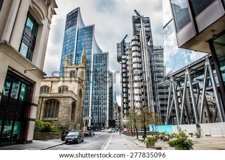 LONDON - APR 11: View of Buildings Lloyd (or Inside-Out Building) home of insurance institution Lloyd of London, on APRIL 11 2015 in London. Like Pompidou Centre in Paris was designed by Rogers (1986) - stock photo