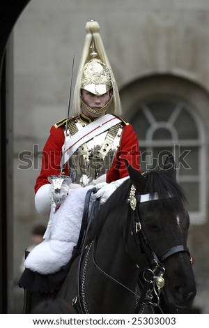 London, April 17: A Horse Guard in London protecting the Queen of England on 17 April 2004 - stock photo