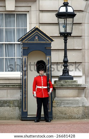 LONDON - APRIL 17: A member of the England Queens' Guard stands guard at Buckingham Palace on April 17, 2004 in London. - stock photo