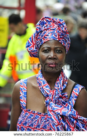 LONDON - APRIL 29 - An unidentified woman  celebrates the Royal Wedding of Prince William and Kate Middleton with red, white and blue fashion on April 29, 2011 at Westminster Abbey in London, England. - stock photo