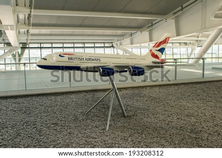LONDON - APRIL 11, 2014: British Airways airplane model in Heathrow airport. British Airways if the flag carrier airline of the United Kingdom, operating 256 aircrafts - stock photo