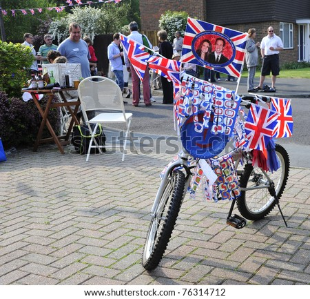 LONDON - APRIL 29 - Child's bicycle adorned with British Royal Wedding memorabilia to celebrate the marriage of Prince William and Kate Middleton on April 29, 2011 in London, England. - stock photo