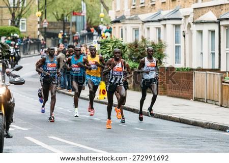 LONDON - APRIL 26: Elite men Eliud Kipchoge, Dennis Kimetto, Stanley Biwott and Wilson Kipsang run the Virgin Money London Marathon on April 26, 2015 in Isle of Dogs, London, England, UK. - stock photo