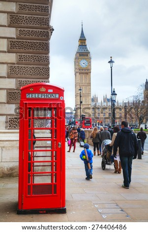 LONDON - APRIL 4: Famous red telephone booth on April 4, 2015 in London, UK. The red telephone box, a telephone kiosk for a public telephone designed by Sir Giles Gilbert Scott. - stock photo
