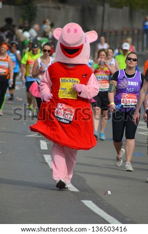 LONDON - APRIL 21:Fun Runners take part in the 2013 London Marathon to raise money for charity on the streets of London April 21st, 2013 in London, England. - stock photo