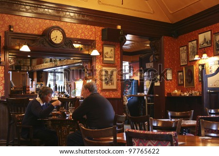 LONDON - APRIL 30: Interior of pub, for drinking and socializing, focal point of the community, on April 30, 2006, London, UK. Pub business, now about 53,500 pubs in UK, has been declining every year - stock photo