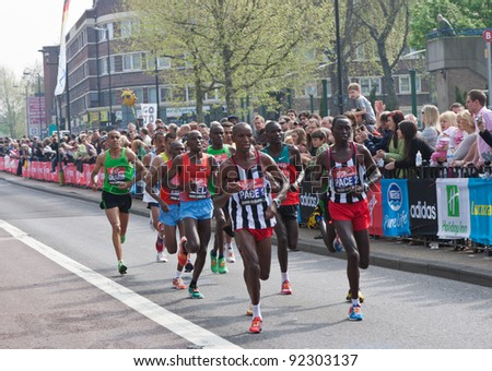 LONDON - APRIL 17: Leading group of runners, including male winner - Emmanuel Mutai (Kenya) and runner-up - Martin Lel (Kenya) during Virgin London Marathon on April 17, 2011 - stock photo