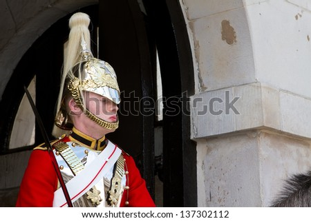 LONDON - APRIL 24: Members of the Household Cavalry on duty at Horse Guards building during the Changing of the Guard in London on April 24, 2012. The Cavalry are the lifeguards of Queen Elizabeth II - stock photo