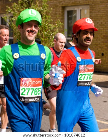 LONDON - APRIL 22: Nash Pradhan and Dan McCormack run the London marathon  dressed as mario and luigi on April 22, 2012 in London, England, UK. The marathon is an annual event. - stock photo