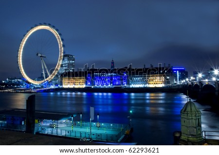 LONDON - APRIL 18: Night view of The London Eye on April 18, 2010 in London, England. At a height of 135m, it is the tallest Ferris wheel in Europe. - stock photo