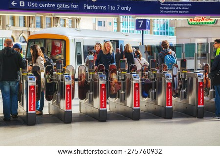 LONDON - APRIL 12: People at the Victoria station on April 12, 2015 in London, UK. Station, generally known as Victoria, is a central London railway terminus and London Underground complex.  - stock photo