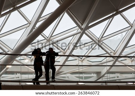 LONDON - APRIL 13, 2013: People silouette inside King's Cross railway station. The annual rail passenger usage between 2011 - 2012 was 27.874 million. - stock photo
