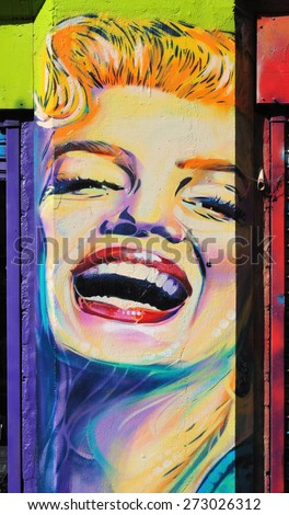 LONDON - APRIL 11, 2015. Street art of Marilyn Monroe painted between shopfronts at Shoreditch in the Borough of Tower Hamlets, an area renown for its public painting in east London, UK. - stock photo
