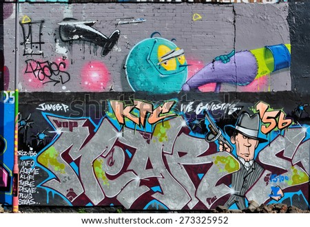 LONDON - APRIL 11, 2015. Street art on an old brick building at Shoreditch in the Borough of Tower Hamlets, an area renown for its public painting in east London, UK - stock photo