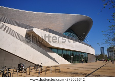 LONDON - APRIL 18. 2015. The Aquatics Centre, designed by Zaha Hadid Architects is a public swimming facility located by the Waterworks River at Stratford in the Borough of Newham, east London, UK. - stock photo
