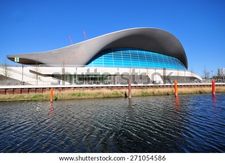 LONDON - APRIL 18. 2015. The Aquatics Centre, designed by Zaha Hadid Architects is now a public swimming facility located by the Waterworks River at Stratford in east London, UK. - stock photo