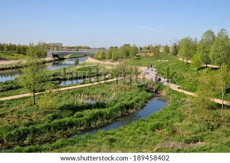 LONDON - APRIL 16. The landscape and River Lea in the new Queen Elizabeth Olympic Park on April 16, 2014, public parkland with recreation and leisure attractions now open at Stratford, London, UK. - stock photo