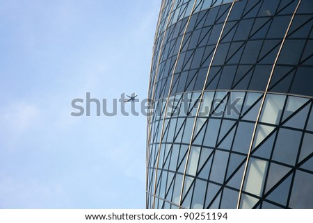 LONDON - APRIL 21: The modern glass buildings of the Swiss Re Gherkin on April 21, 2010 in London, England. This tower is 180 meters tall and stands near Liverpool Street Station in City of London. - stock photo