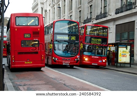 LONDON - APRIL 3: The much heralded hybrid 'New Bus For London' is now in service in the city of London. April 3, 2012 in London. London, the UK. The icons of England red buses  - stock photo