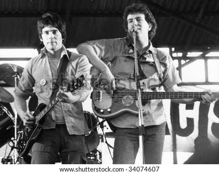 LONDON-APRIL 30: Tom Robinson with Danny Kustow (left) of British pop group The Tom Robinson Band, perform live on stage on April 30, 1978 in London.