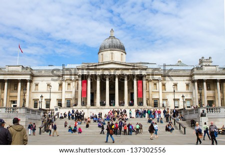LONDON -APRIL 24:Tourists visit the National Gallery on April 24th 2013. The gallery houses a rich collection of over 2,300 paintings dating from the mid-13th century in its home on Trafalgar Square. - stock photo